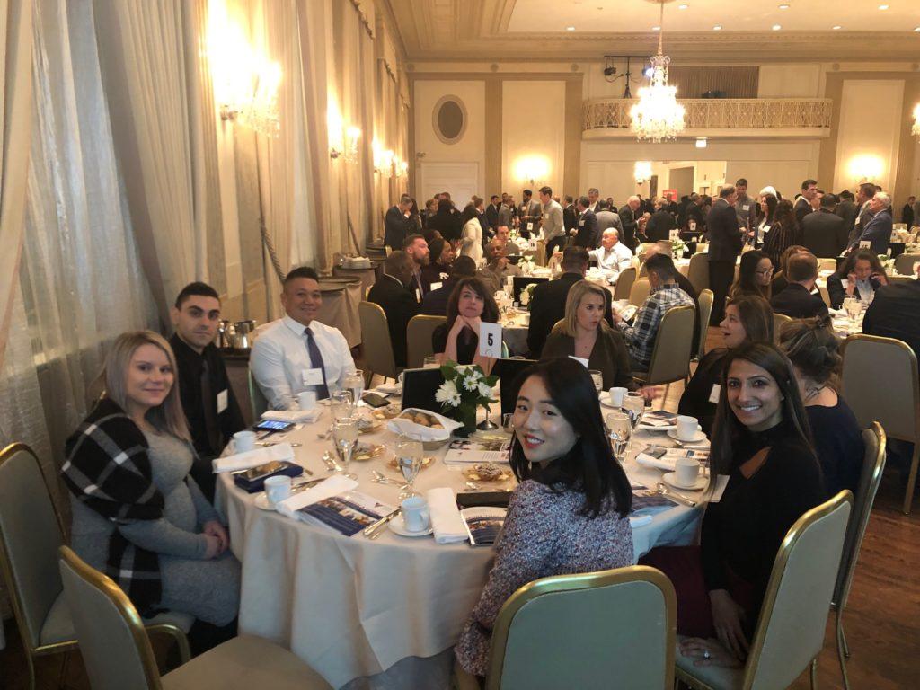 Credico team members enjoying the Volunteers of America Leadership Luncheon