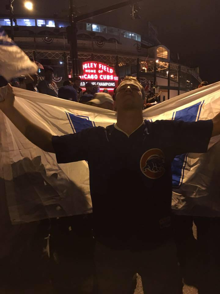 Blake celebrates the 2016 World Champion Chicago Cubs in front of Wrigley Field